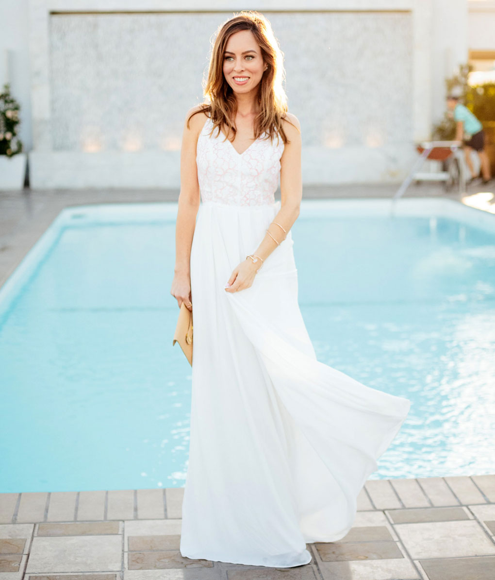 Sydne Style wears a fame and partners white maxi dress