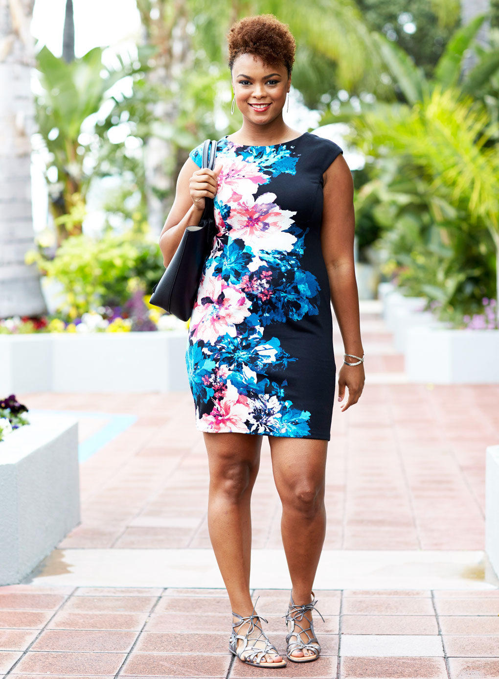 Sydne Style shows how to wear floral dresses for spring on lipstick giraffe