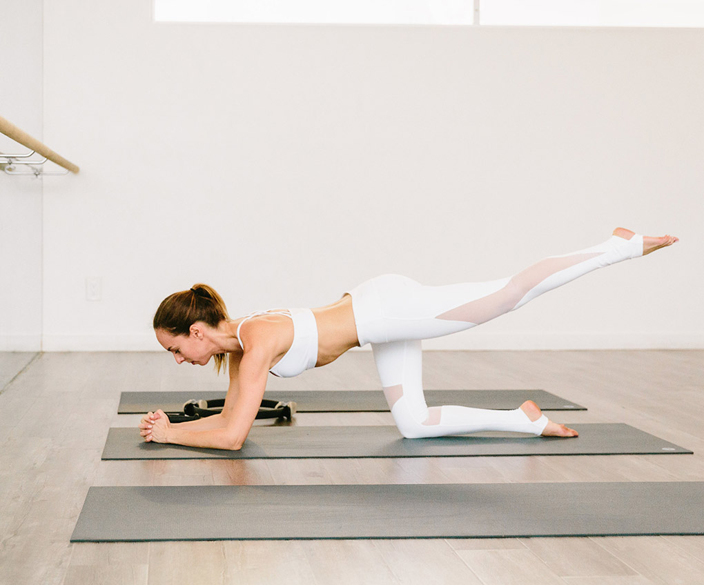 Sydne Style wears Alo yoga white fitness fashion trends for summer
