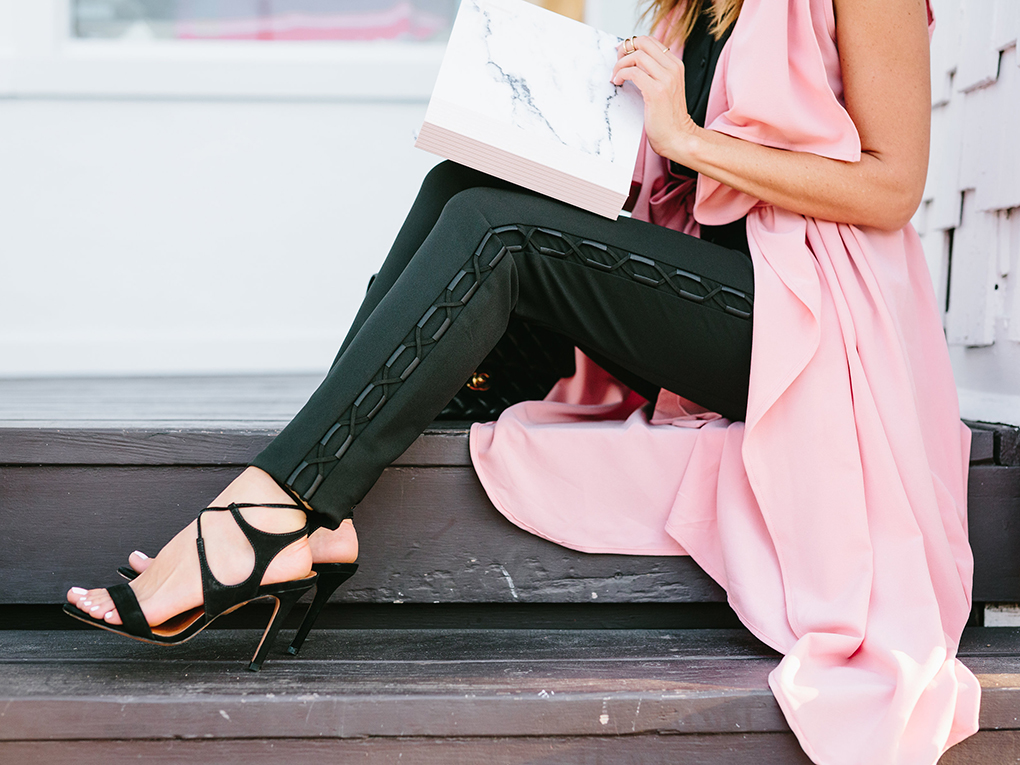Sydne Style wears Express lace up work pants and La Canadienne sandals