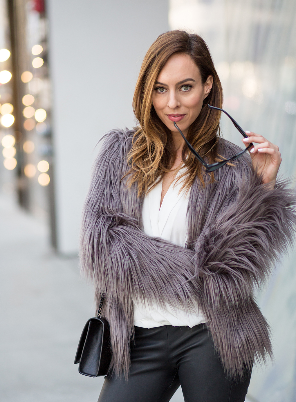 Sydne Style shows what to wear with a fur coat for holiday party style