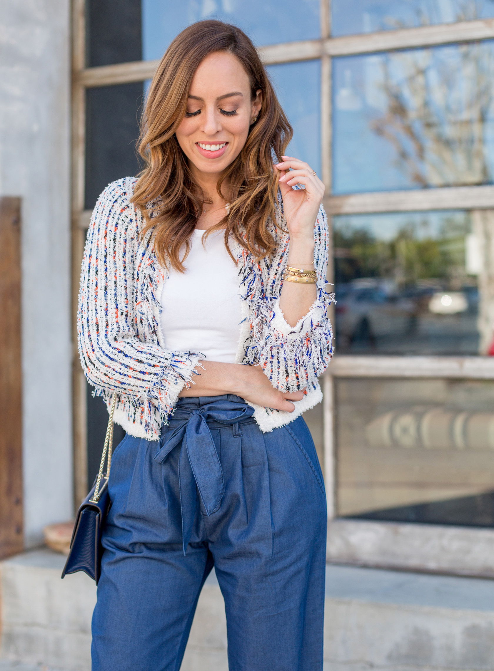 Sydne Style shows how to wear a cropped cardigan for office outfit ideas