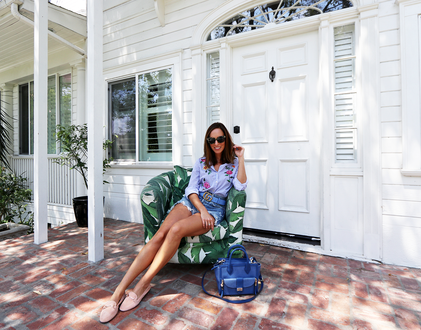 Sydne Style shows palm print chairs at lombardi house hollywood