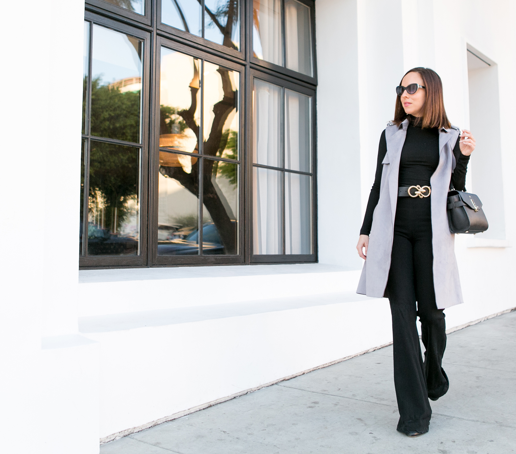 Sydne Style shows chic office outfit ideas in bebe gray trench vest