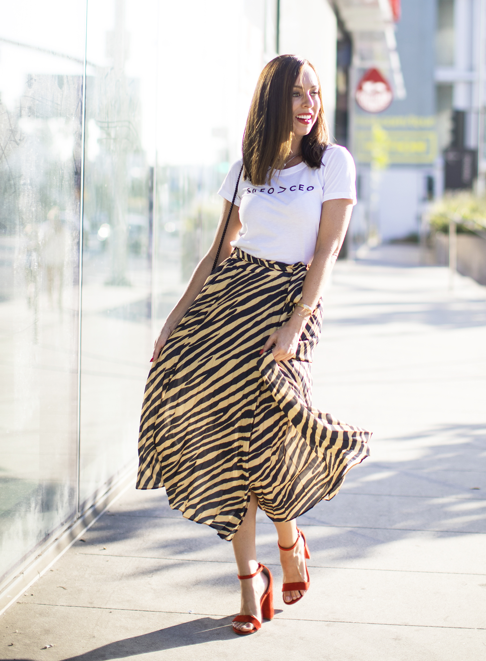 Sydne Style shows how to wear graphic tees with zebra print skirt