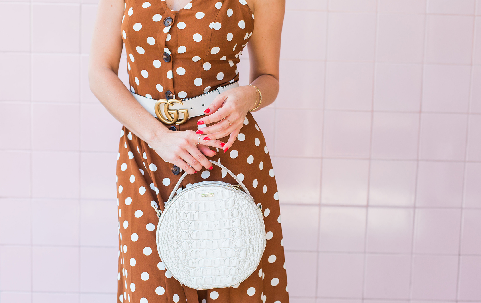 Sydne Style wears gucci belt in cream with polka dot dress
