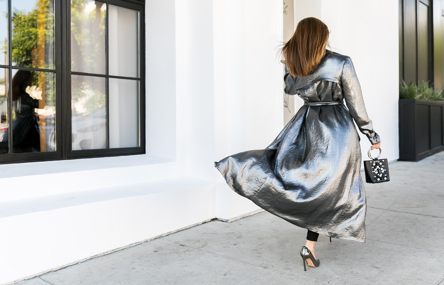 Sydne Style wears house of harlow silver trench for holiday party outfit ideas