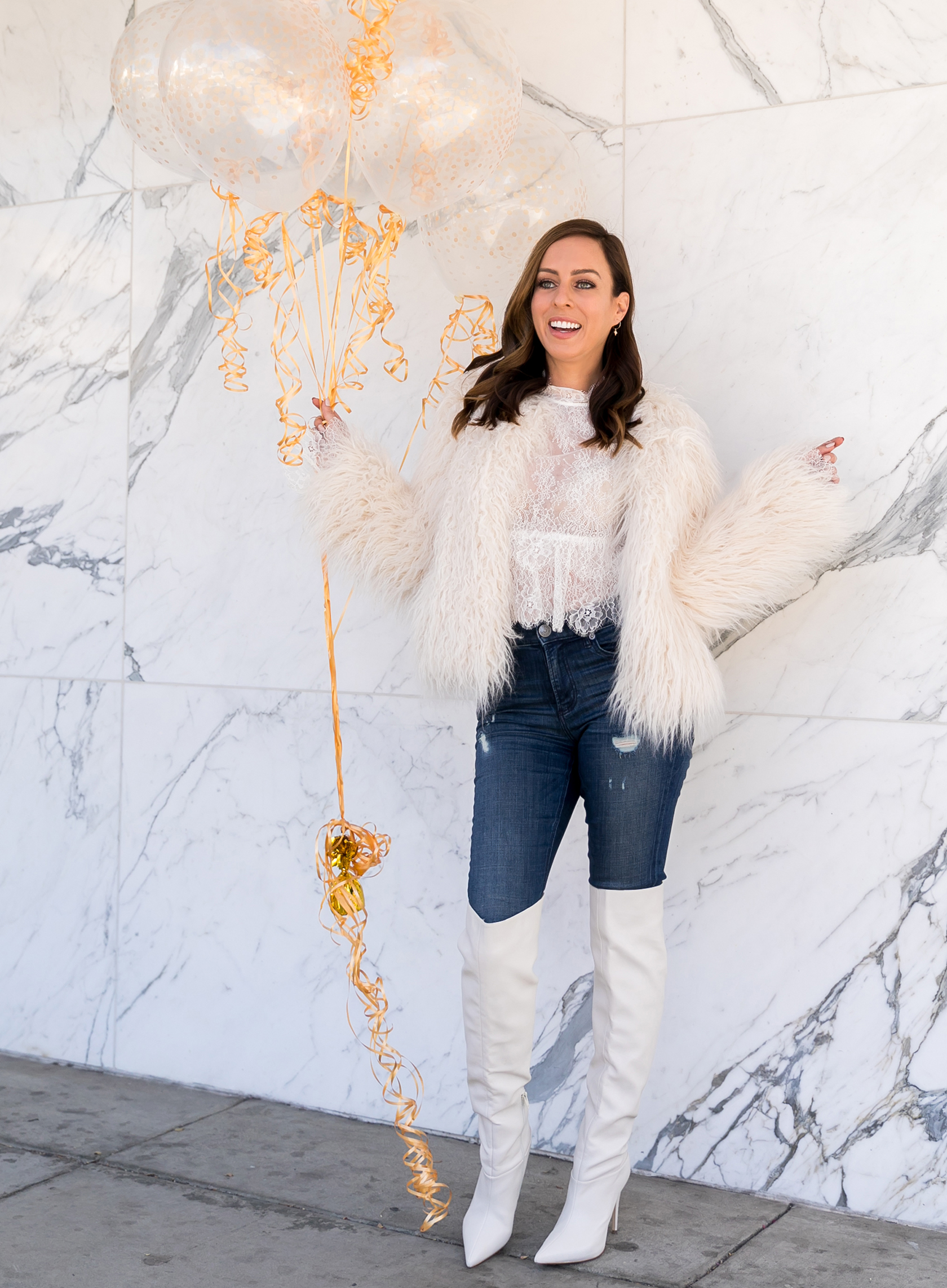 Sydne Style shows what to wear with over the knee boots for winter outfit ideas with white fur