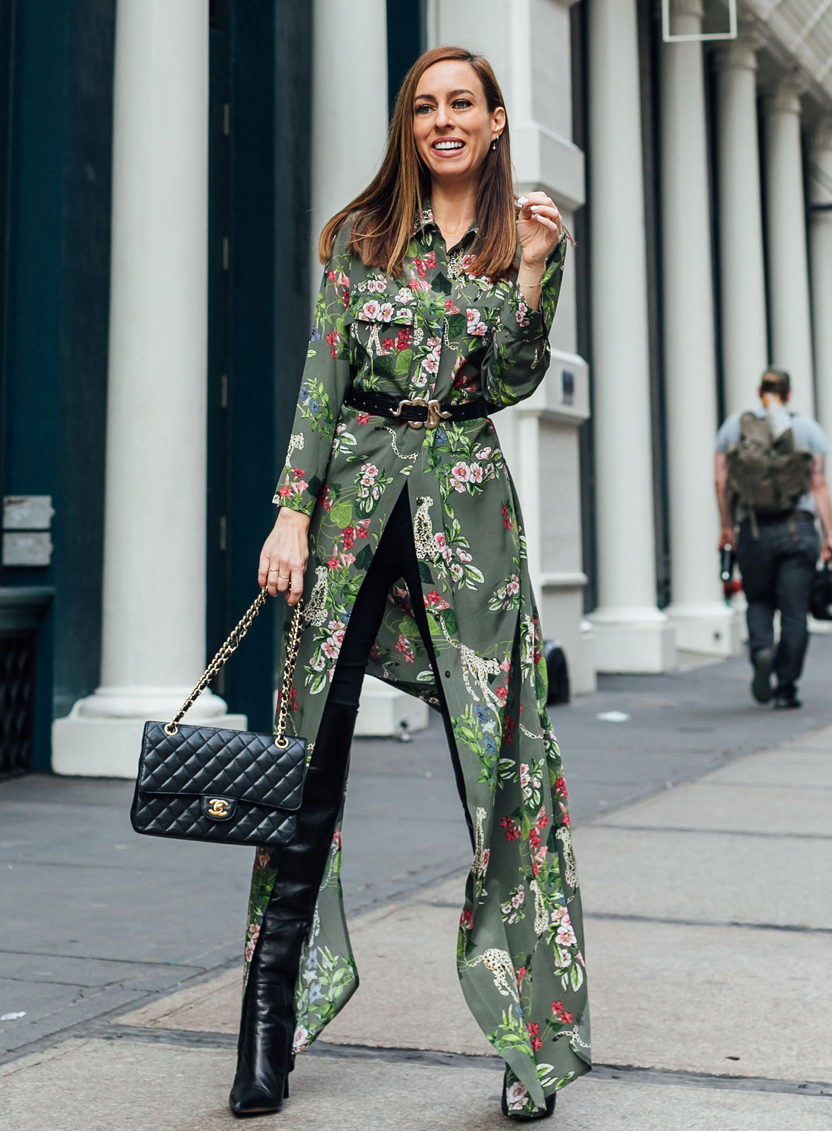 Sydne Style shows how to wear a shirtdress with jeans in l'agence at fashion week