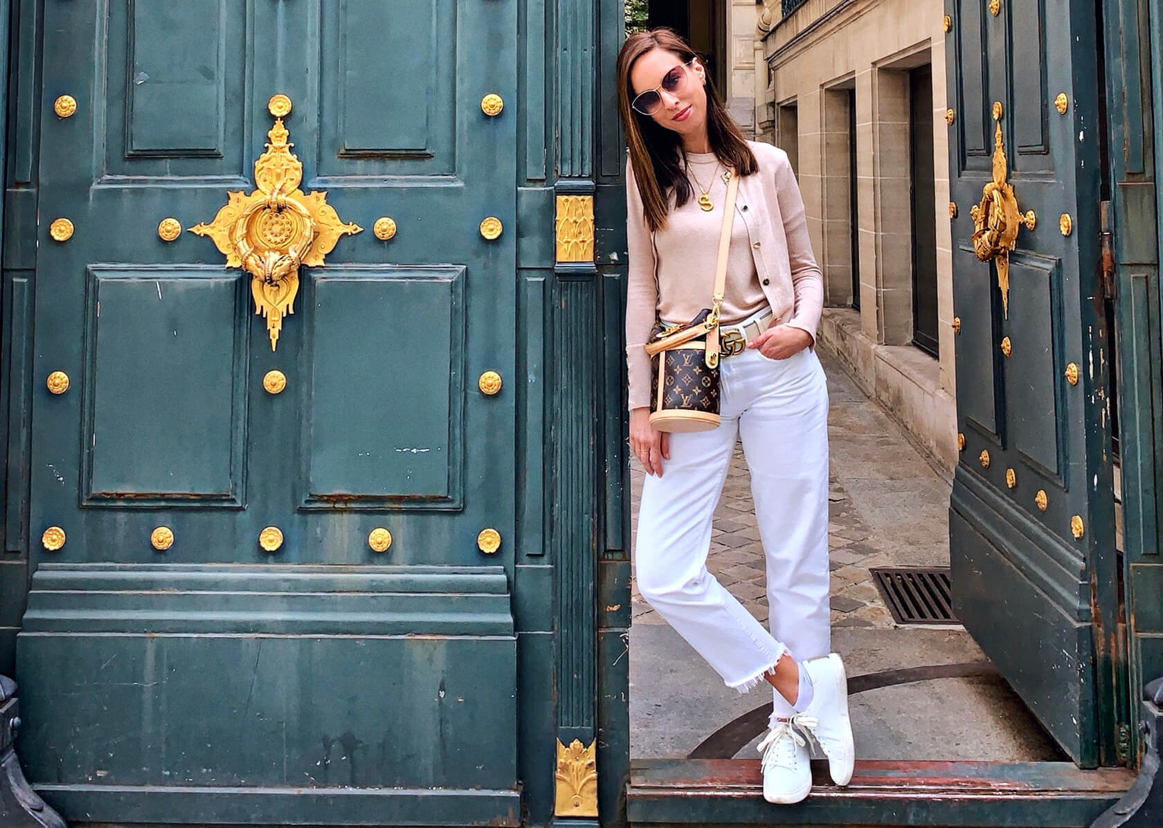 Sydne Style shows what to wear to Paris in May in neutrals outfit with white jeans