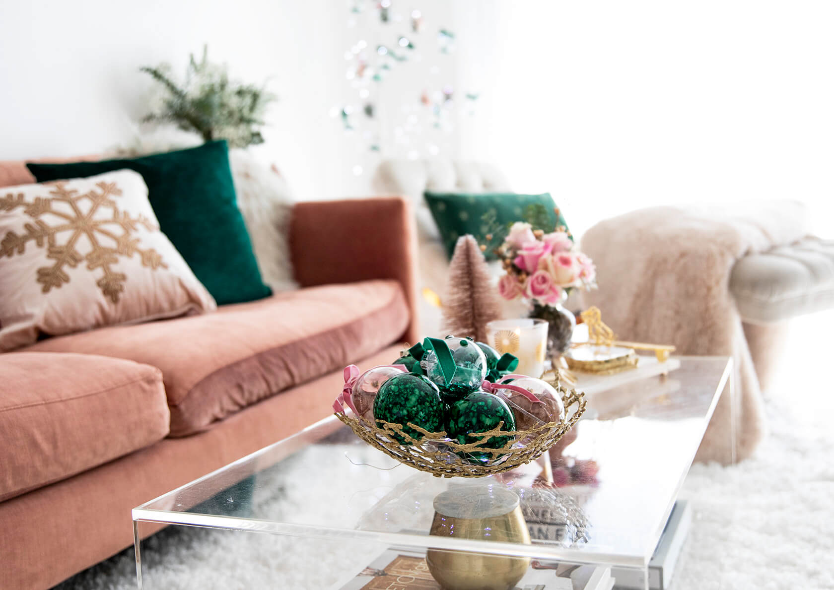 Sydne Style shows how to decorate a coffee table for christmas with ornaments decor