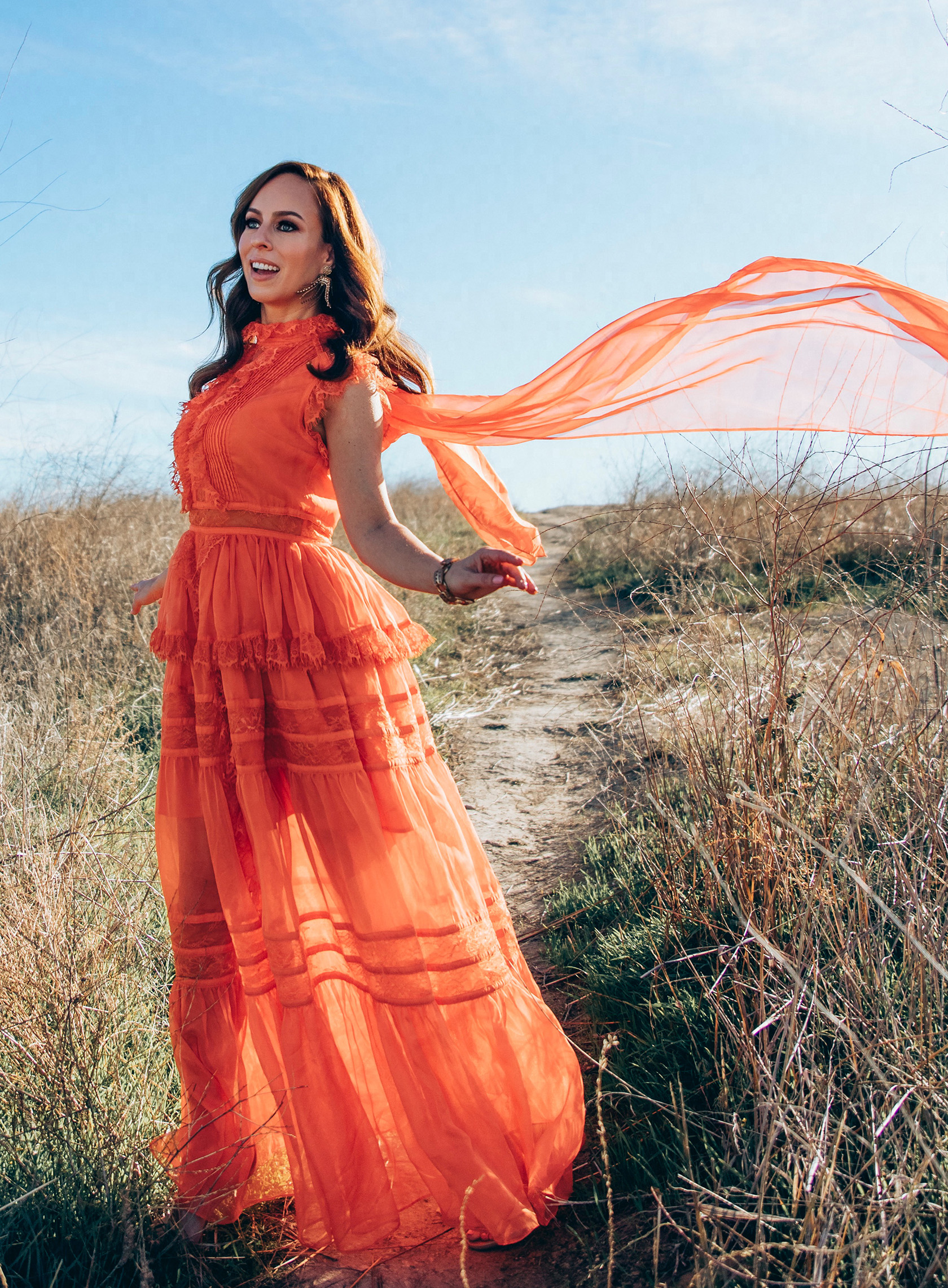 Sydne Style wears elliatt orange dress with sheer bow