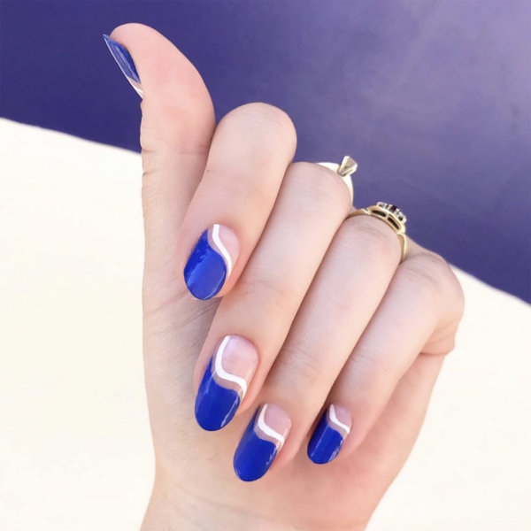 Sydne Style shows July 4th nail ideas with patriotic negative space mani by