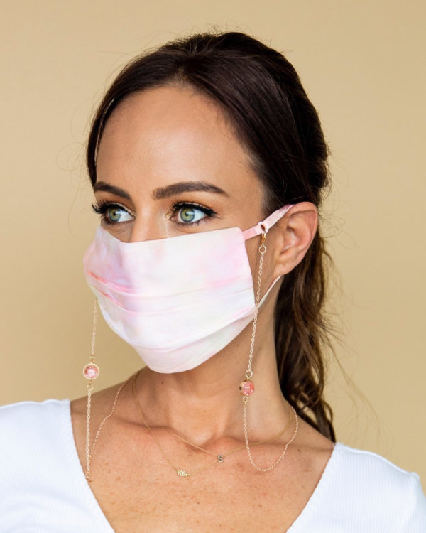 Sydne Summer in pink tie dye face mask and mask chain