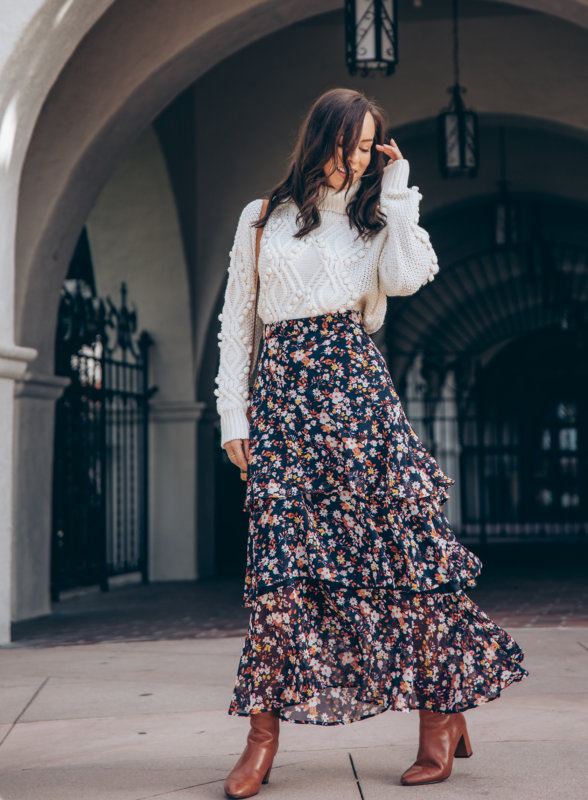 Sydne Style shows how to wear a maxi skirt for winter with chunky knits