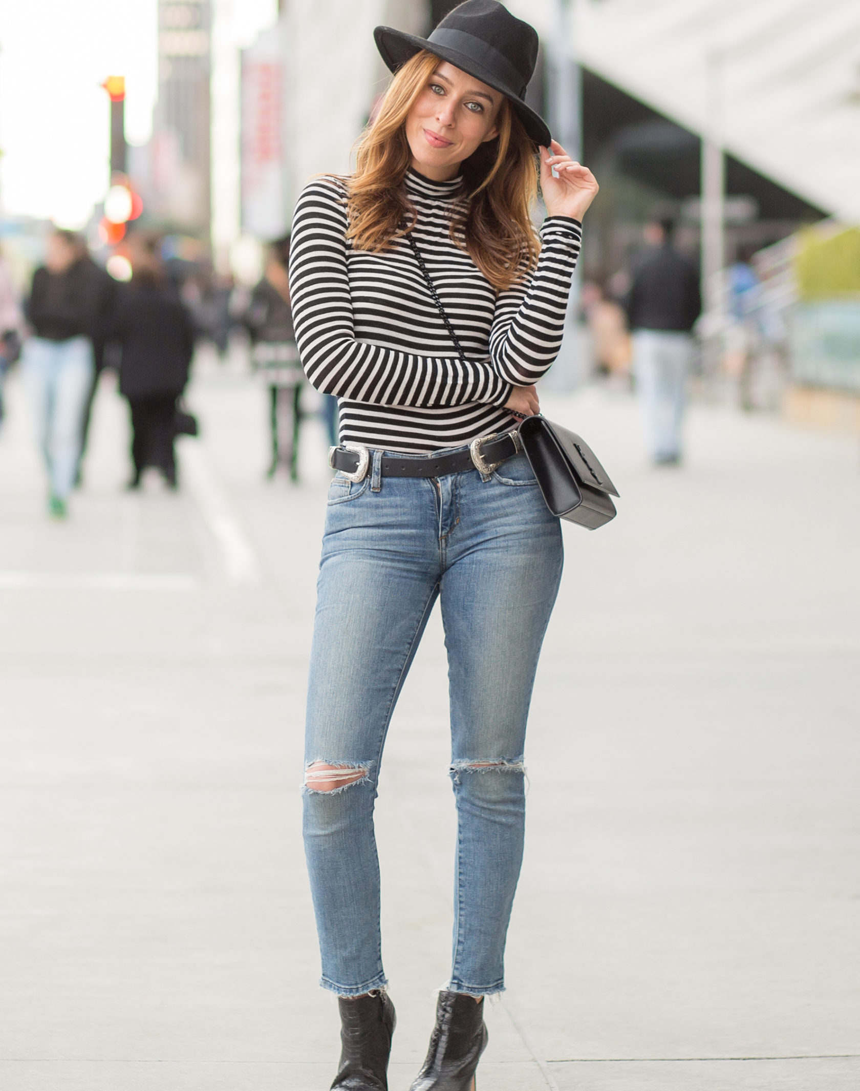 Sydne Style shows how to wear the stripe trend in winter in forever 21 turtleneck and joes jeans