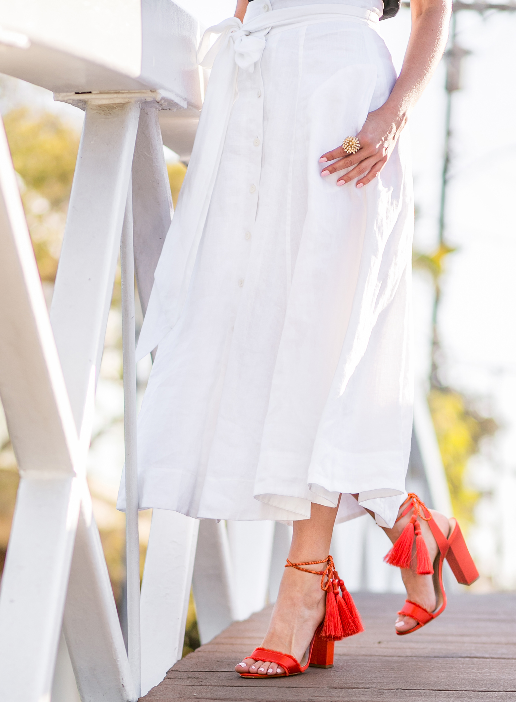 Sydne Style wears Carlisle white linen skirt for summer outfit ideas