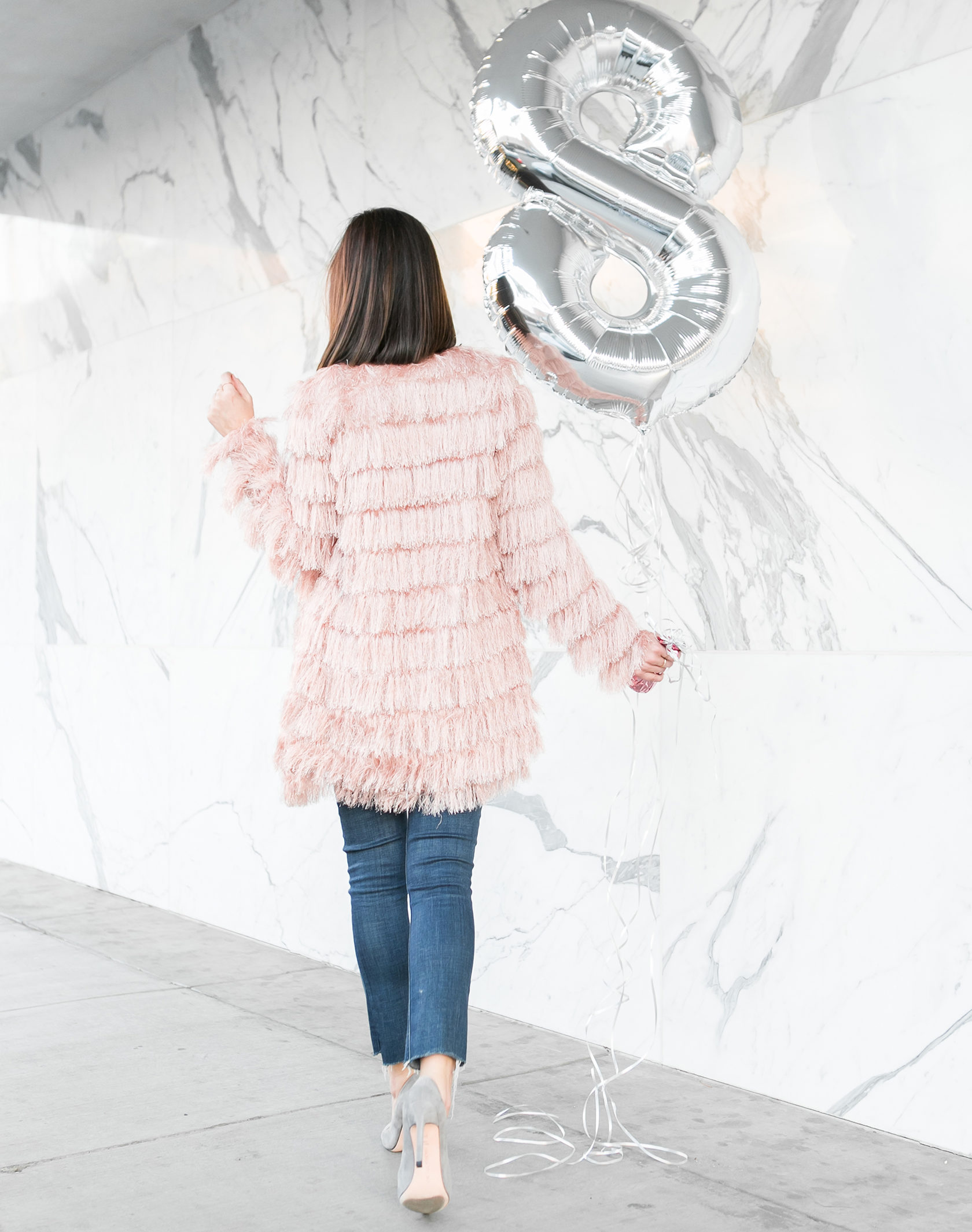 Sydne Style shows how to wear the fringe trend in blush jacket