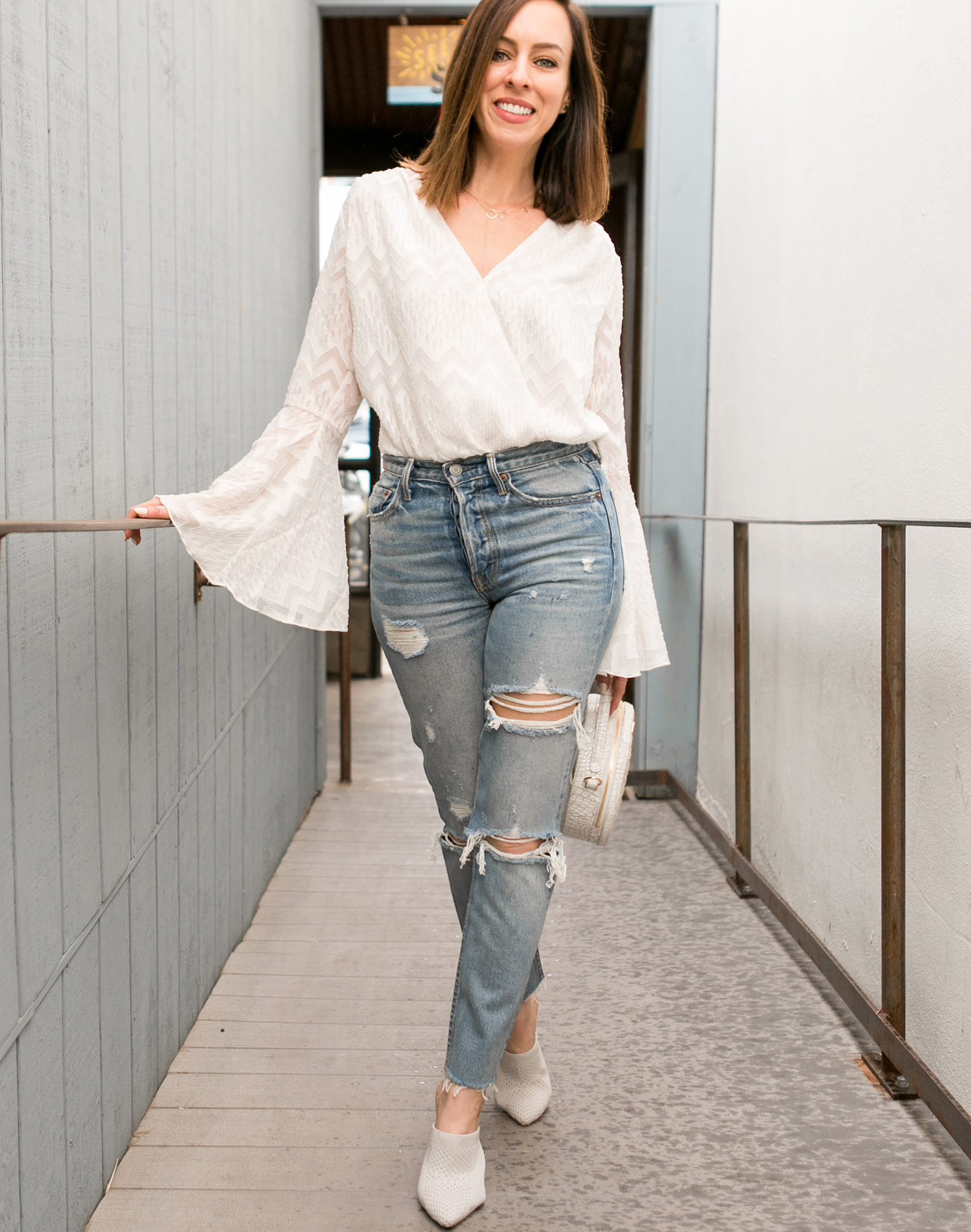 Sydne Style shows the best bell sleeves tops in wayf bodysuit