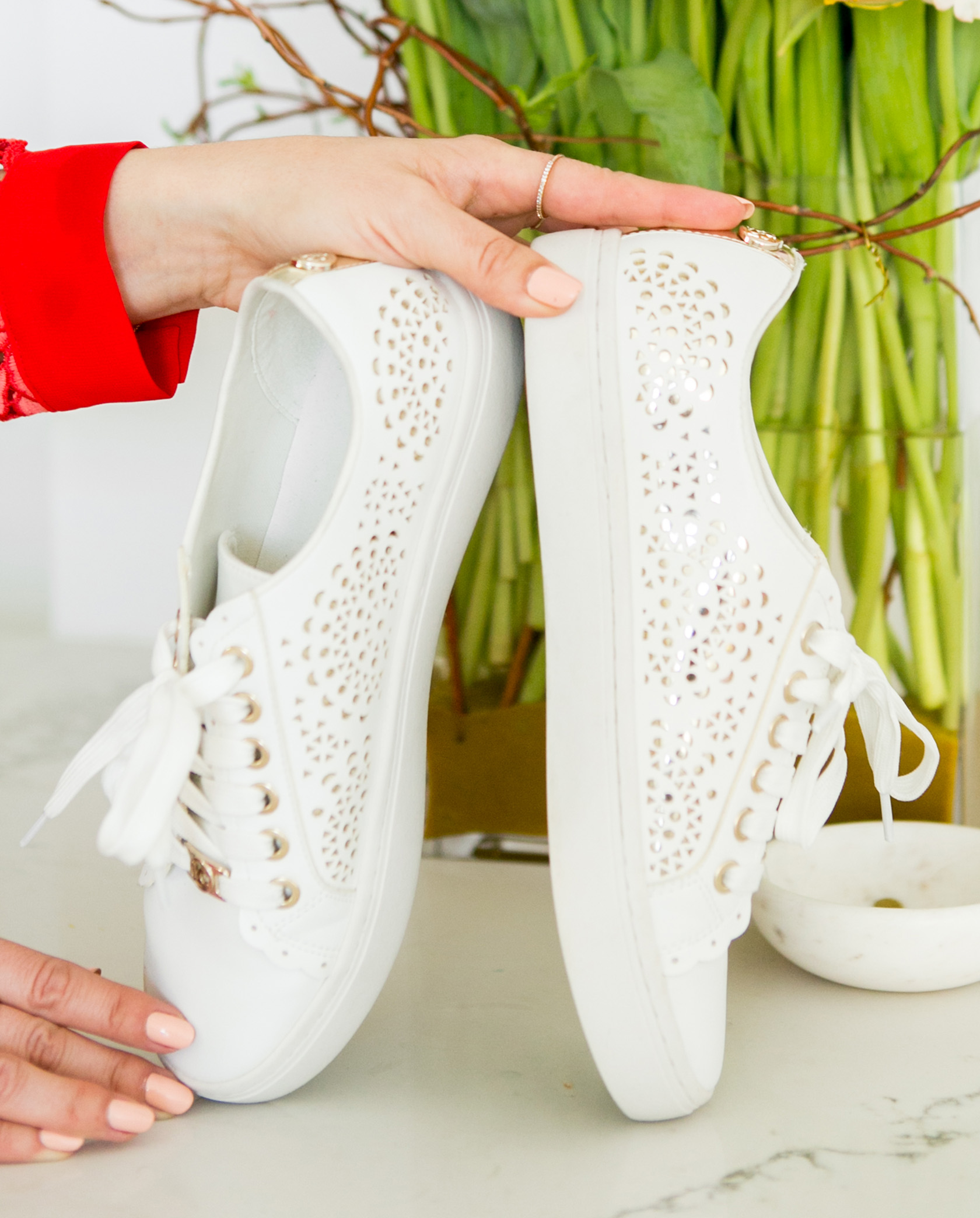Sydne Style shows the best white sneakers with liz claiborne laser cut sneakers