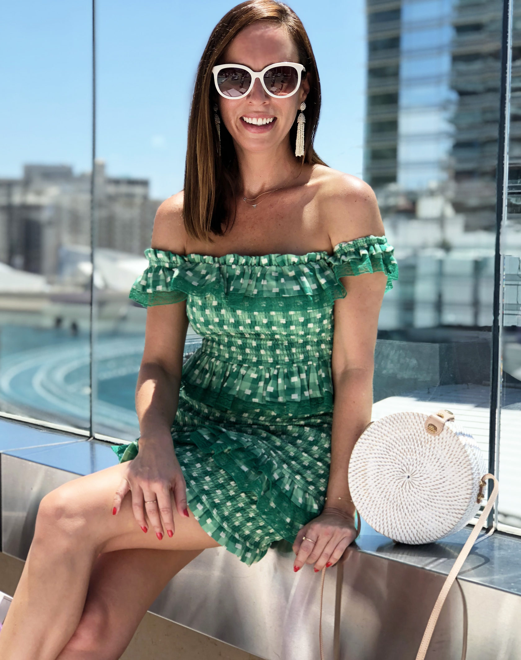 Sydne Style shows what to wear to a las vegas pool party in off the shoulder dress