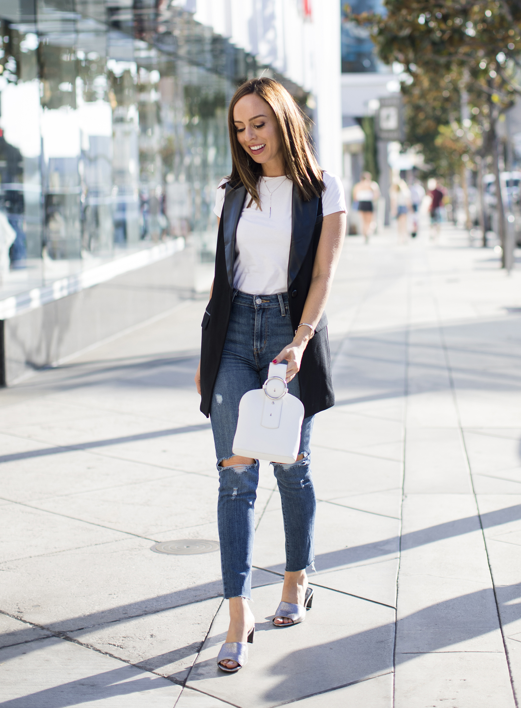 Sydne Style shows casual outfit ideas with rachel zoe leather vest