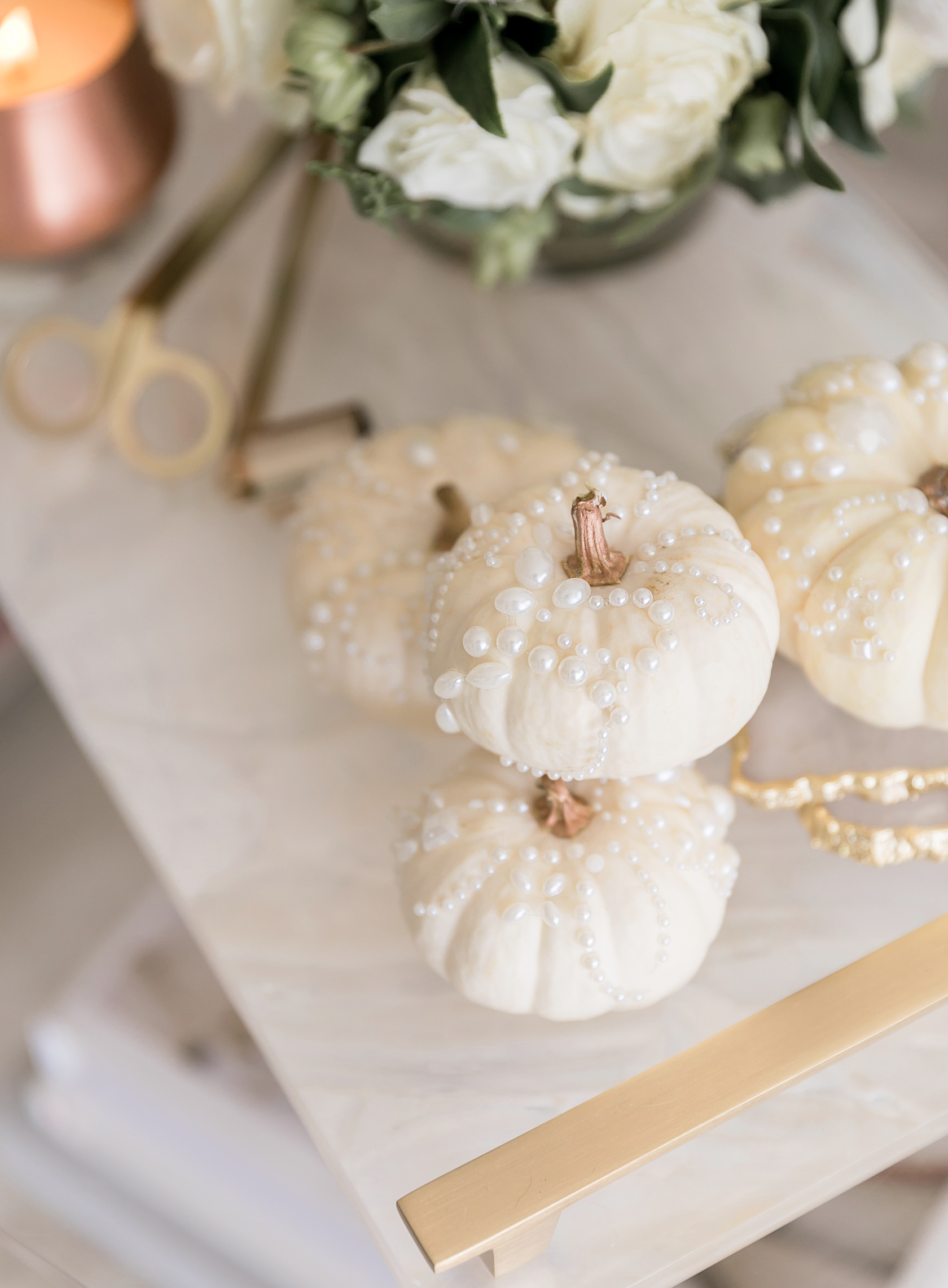 Sydne Style shows fall decor ideas with white pearl pumpkins