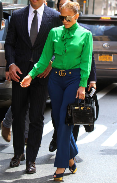 Sydne Style shows how dress like jlo in gucci green top and navy patns