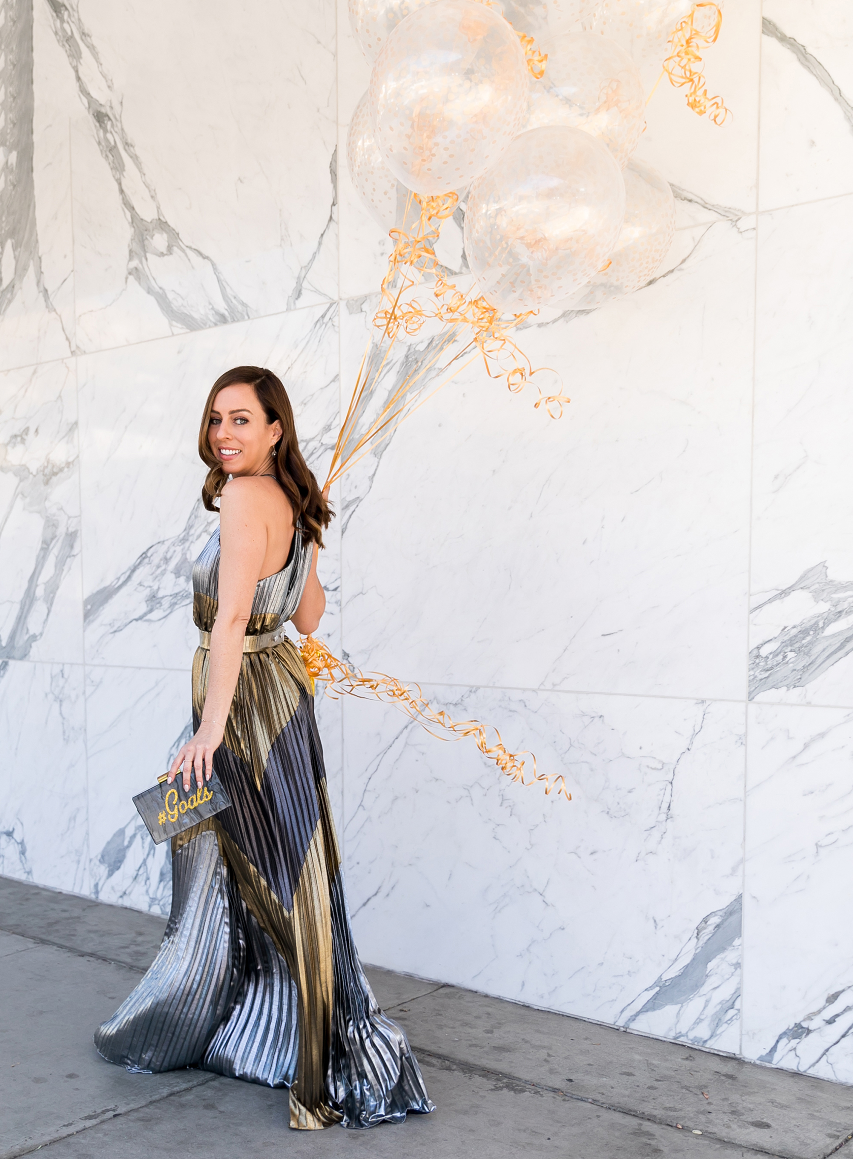 Sydne Style wears metallic pleated maxi dress for new years eve outfit ideas