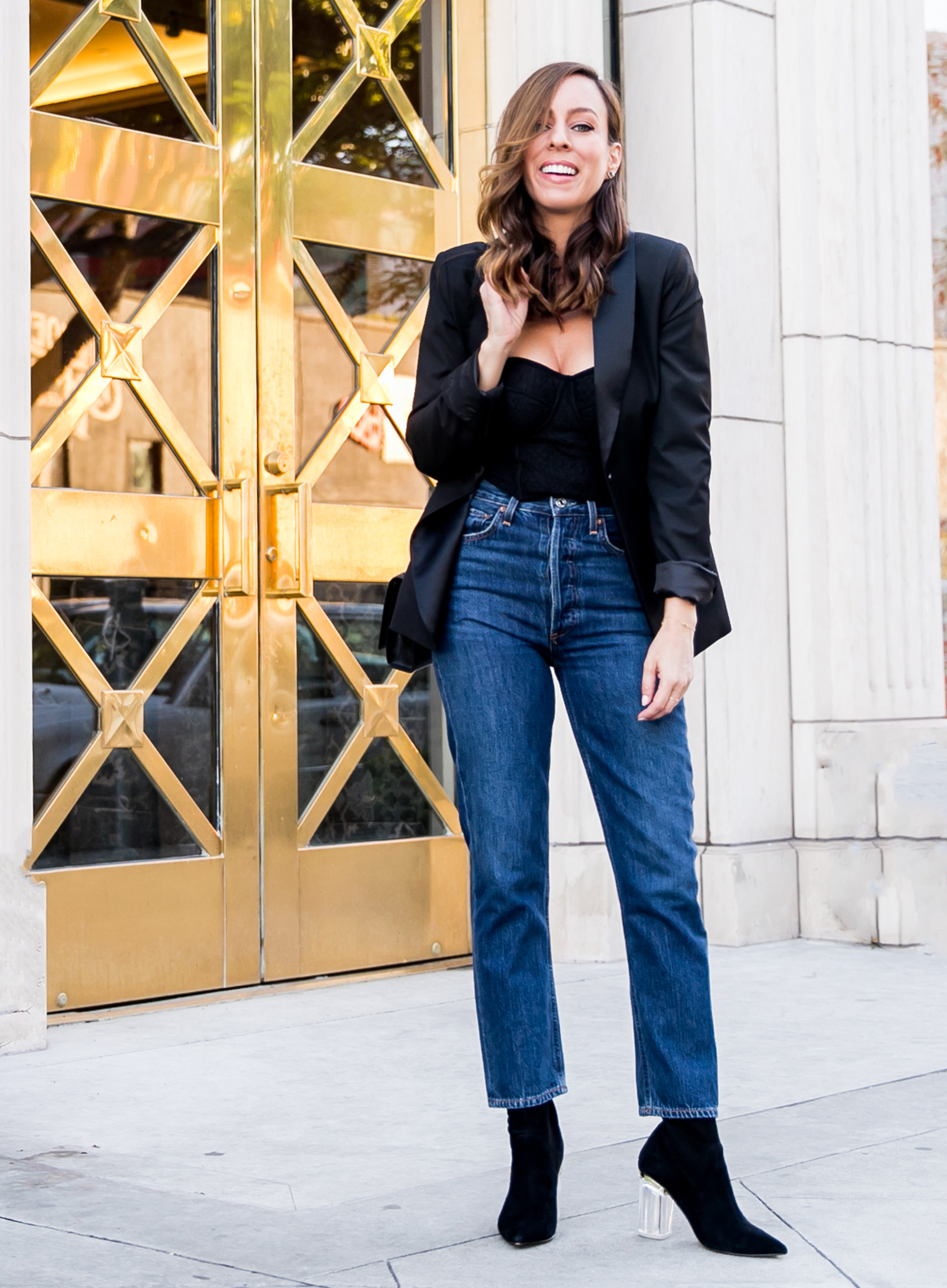 Sydne Style shows how to wear a tuxedo blazer with corset and jeans