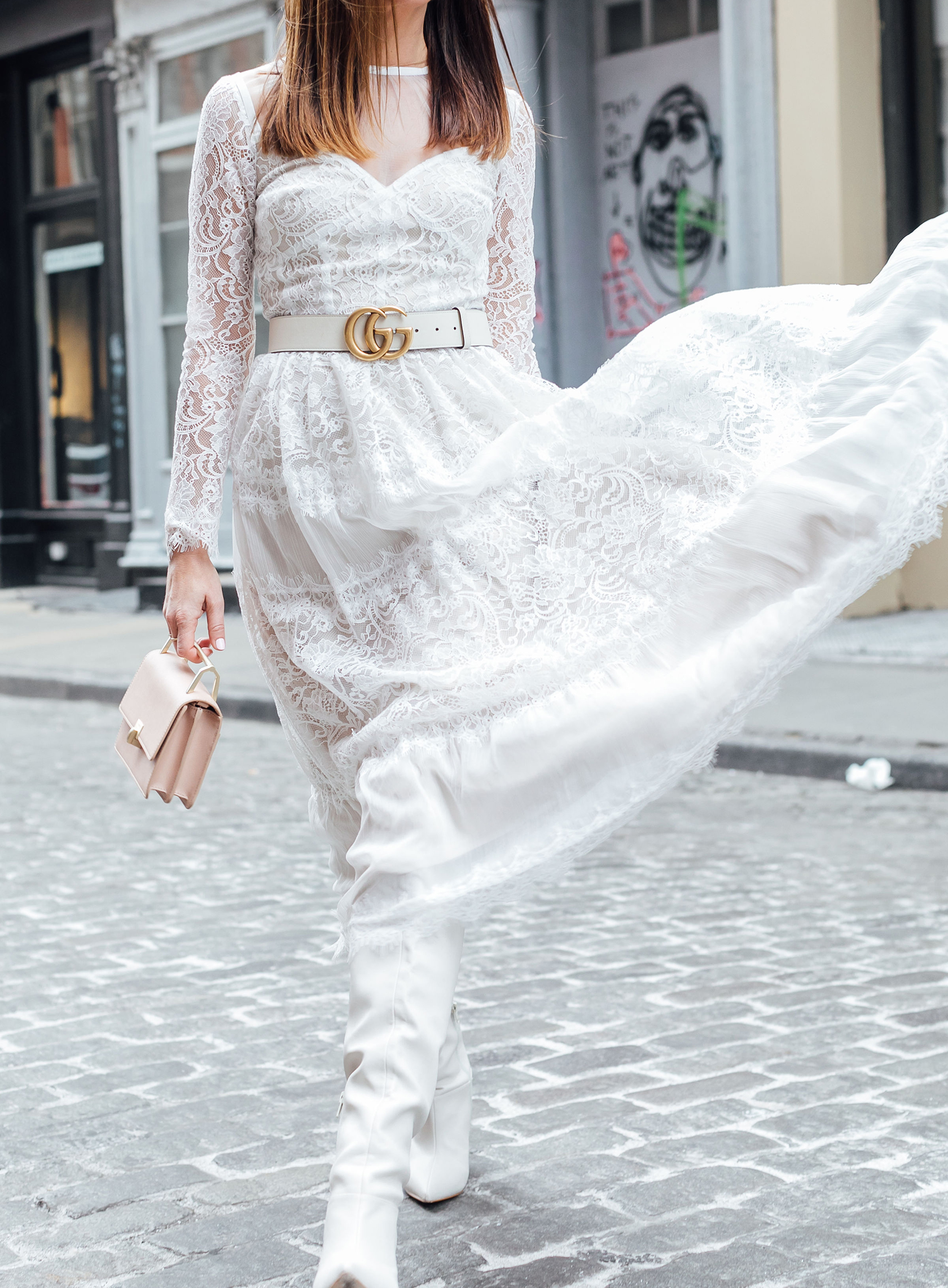 Sydne Style shows how to wear a lace dress with boots for spring style