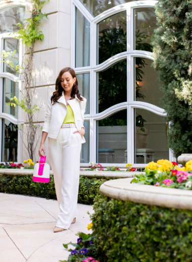Sydne Style shows how to wear the neon trend in hot pink bag and something navy white pants