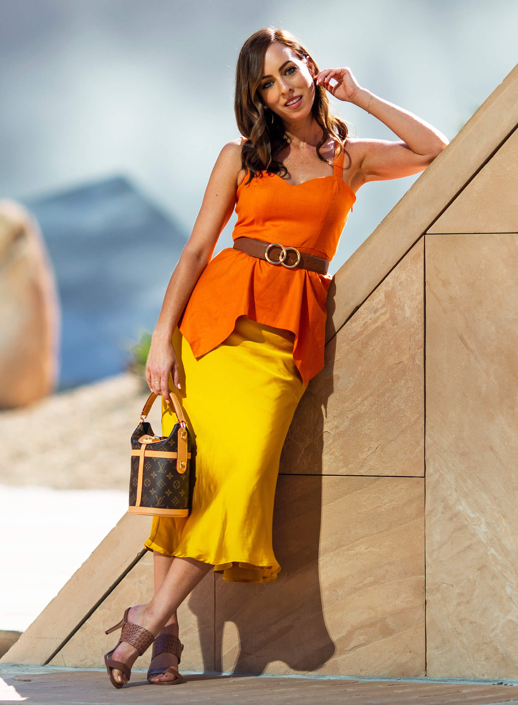 Sydne Style shows how to wear orange and yellow for colorful fall outfit ideas