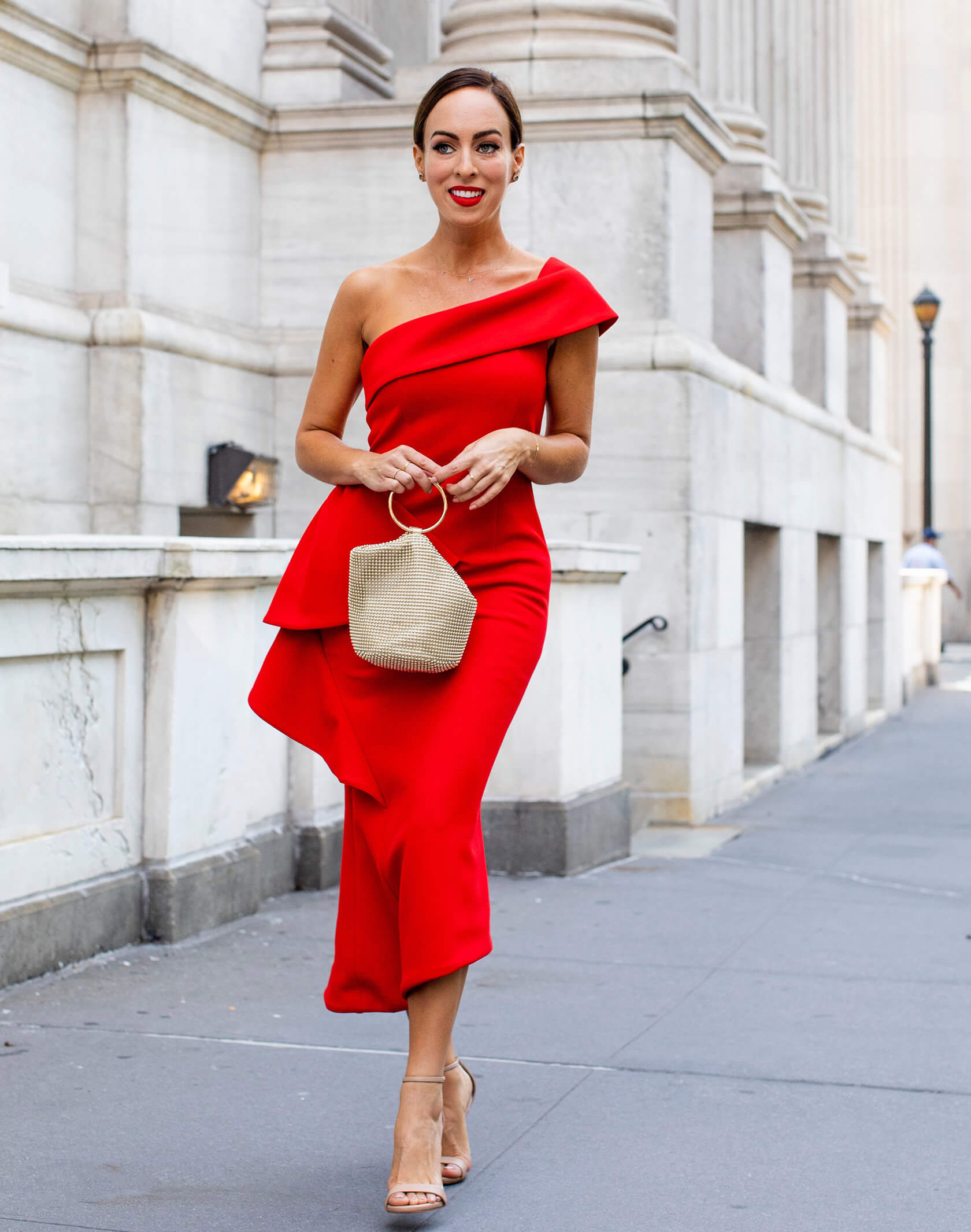 Sydne Style wears elliatt red one shoulder dress for holiday dress ideas