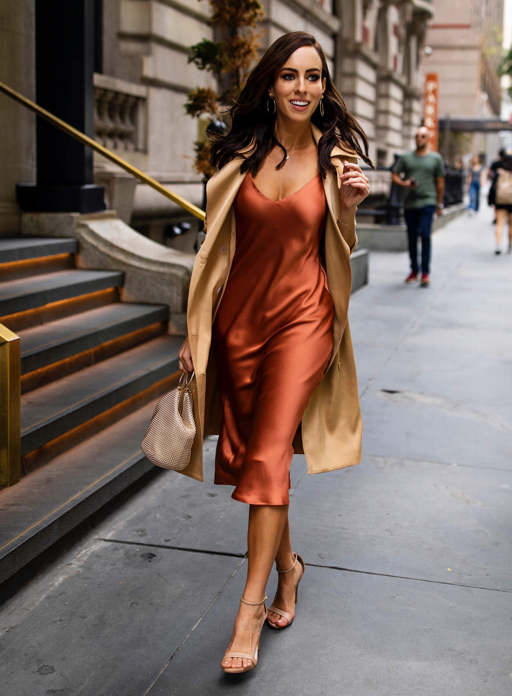 Sydne Style wears shows how to wear pumpkin spice dresses in l'agence silk trench coat with slip dress