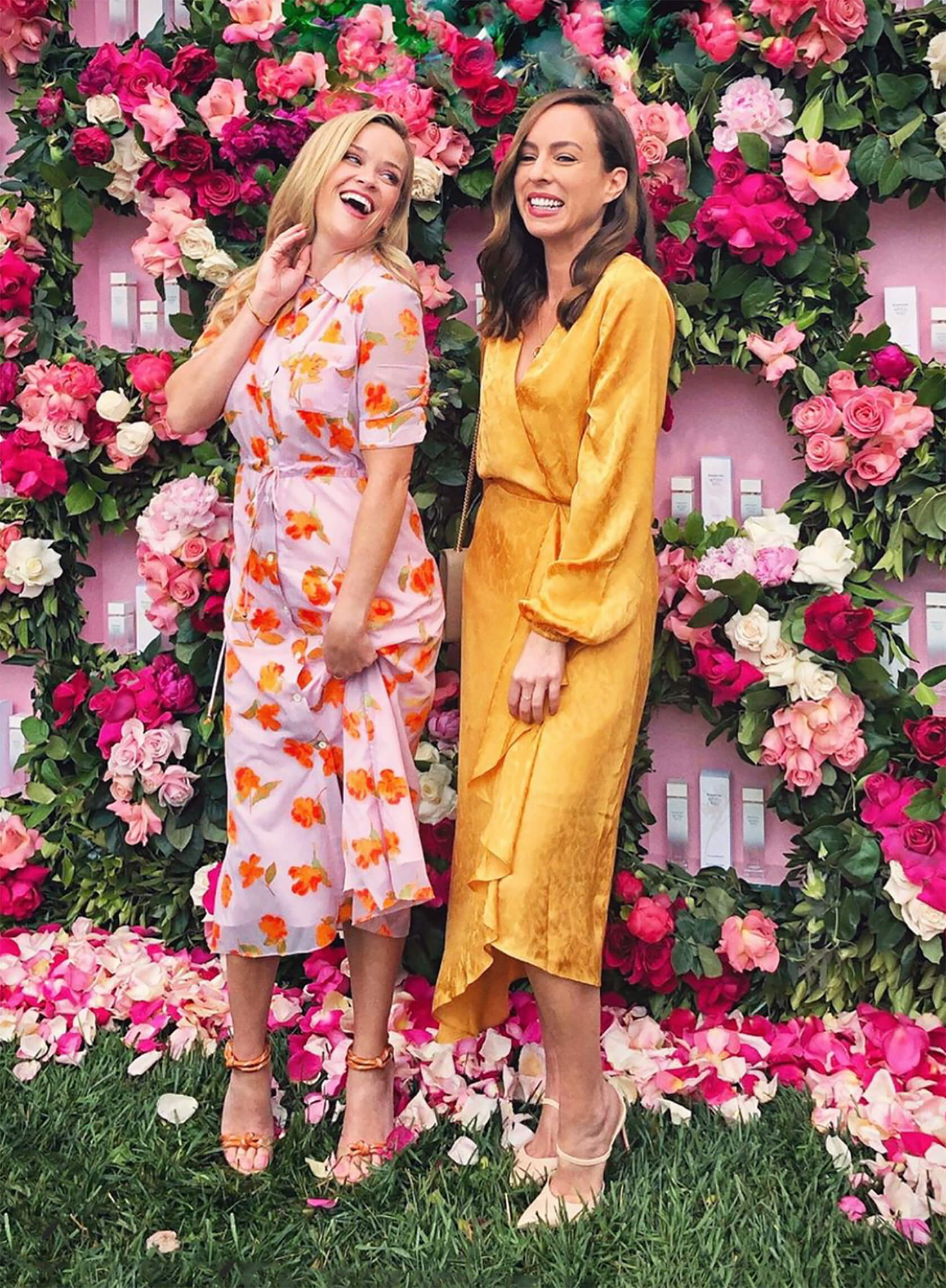 Sydne Style shows pretty floral dresses with Reese Witherspoon at Elizabeth Arden event