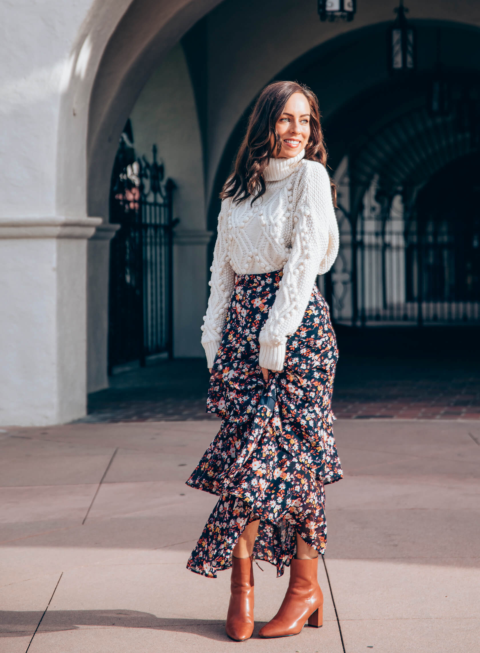Sydne Style shows how to wear a maxi skirt with sweater and boots